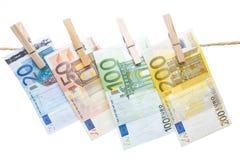 Банкноты евро вися от веревочки Стоковое Изображение RF