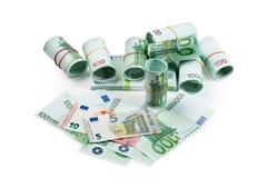 Банкноты евро в стогах и кренах Стоковые Фотографии RF