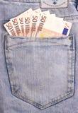 Банкноты евро в темном сером карманн джинсов Стоковое фото RF