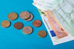 Банкноты евро на голубой предпосылке Стоковое фото RF