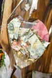 Банкноты заполнили внутри стекло Стоковые Изображения