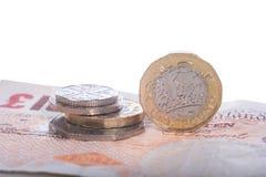 Банкноты и монетки английского фунта стерлинговые Стоковое Фото