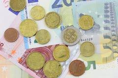 Банкноты и монетки евро закрывают вверх в студии Стоковое фото RF