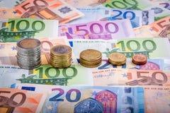 Банкноты и монетки евро Стоковые Фото