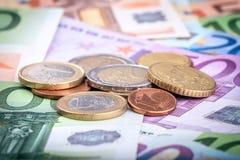 Банкноты и монетки евро Стоковая Фотография