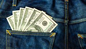 Банкноты доллара в карманн задней части демикотона Стоковая Фотография