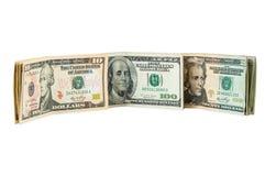 Банкноты доллара на белой предпосылке Стоковые Изображения