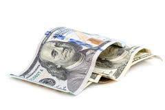 Банкноты доллара на белой предпосылке Стоковые Фотографии RF