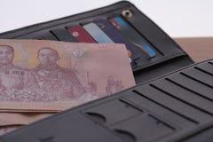 Банкноты положили в бумажник стоковые фотографии rf