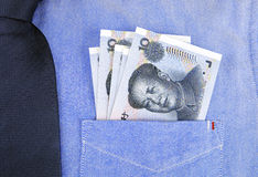 Банкноты RMB в карманн рубашки Стоковые Фотографии RF