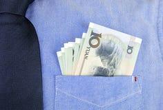 Банкноты RMB в карманн рубашки Стоковые Изображения