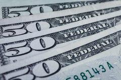Банкноты 50 usd подсчитывая предпосылку стога соответственно, Америку Стоковая Фотография RF