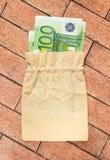 100 банкнот евро в linen мешке Стоковые Фотографии RF
