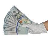 100 банкнот доллара в форме вентилятора руки Стоковые Фото