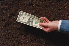 Банковская ссуда для аграрной деятельности в банкнотах доллара США Стоковые Изображения