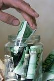 Банк с деньгами Стоковая Фотография