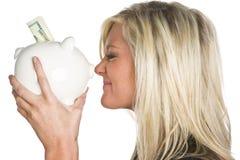 банк держа piggy женщину Стоковое Изображение