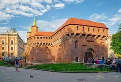 Барбакан, укрепленный аванпост старого городка Кракова, Польши стоковые фотографии rf