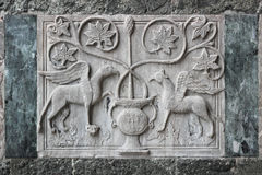 Барельеф на внешней стене базилики St Mark стоковые фото