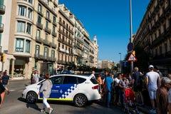Барселона, Испания - 17-ое августа 2017: испанская полиция патрулирует cit Стоковое Фото