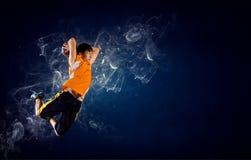 Баскетболист на огне стоковое изображение rf