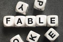 Басня слова на кубах игрушки стоковое фото