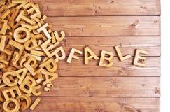 Басня слова сделанная с деревянными письмами стоковое фото rf