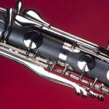 басовый кларнет пользуется ключом красный цвет Стоковая Фотография RF