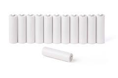 Батареи AA стоят в ряд Стоковые Фото