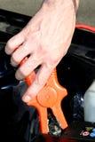Батарея автомобиля с зарядным кабелем Стоковые Фото