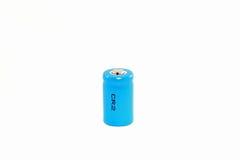 батарея cr2 предпосылки изолировала белизну лития Стоковые Фото