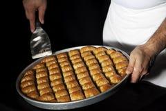 Бахлава, турецкий десерт сделанный из тонкого печенья, гайки и мед Стоковое Изображение
