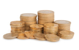 Башни золотых монеток изолированных на белой предпосылке Стоковые Фото
