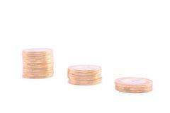 Башни монеток изолированные на белизне Стоковое Фото