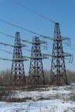 3 башни передачи электрических с предпосылкой голубого неба Стоковые Изображения