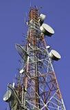 Башни радиосвязи против голубого неба Стоковое Изображение