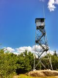 Башня и небо огня Стоковая Фотография