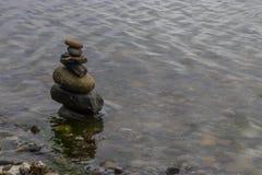Башня камня в воде Стоковое Изображение