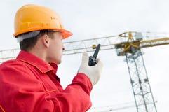 башня крана строителя работая Стоковое фото RF