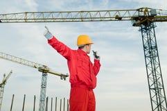 башня крана строителя работая Стоковые Изображения RF