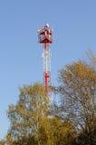 Башня клетки среди деревьев Стоковое Изображение