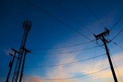 Башня силы и силуэт башни сотового телефона Стоковые Изображения