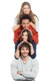Башня счастливых multi расовых друзей Стоковое Изображение RF