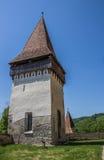 Башня церковь-крепости румынского городка Biertan стоковые фотографии rf