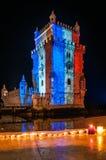 Башня Belém с цветами флага Франции Стоковое Изображение RF