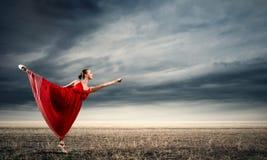 Балерина в красном платье Стоковая Фотография