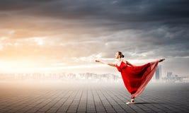 Балерина в красном платье Стоковое фото RF