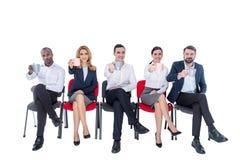 Бдительные коллеги имея перерыв на чашку кофе Стоковое Фото
