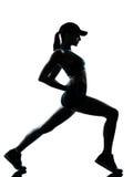 бегунок jogger протягивая вверх по теплой женщине Стоковое Изображение
