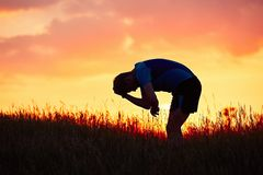 Бегун на заходе солнца Стоковое Фото